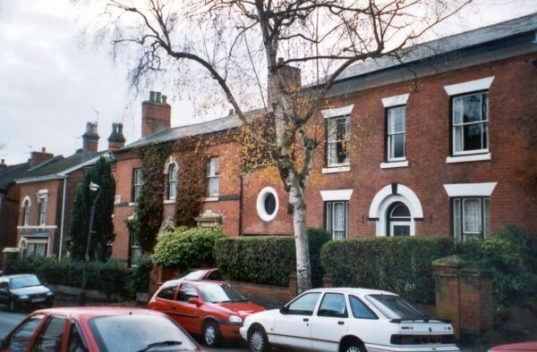Villas on the Avenue. The house with the ivy has a plaque 'Baskerville House 1871'.