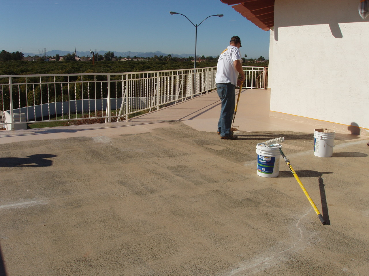 EnviroCoatings - Began applying the first coat of Ceramic InsulCoat Roof at 9AM.  Notice how Ceramic InsulSeal has dried clear.