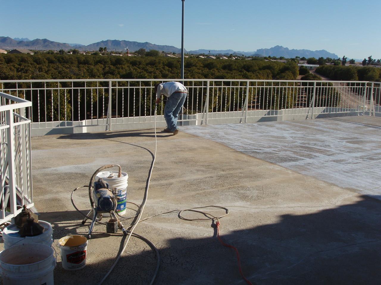 EnviroCoatings - Spraying Ceramic InsulSeal.
