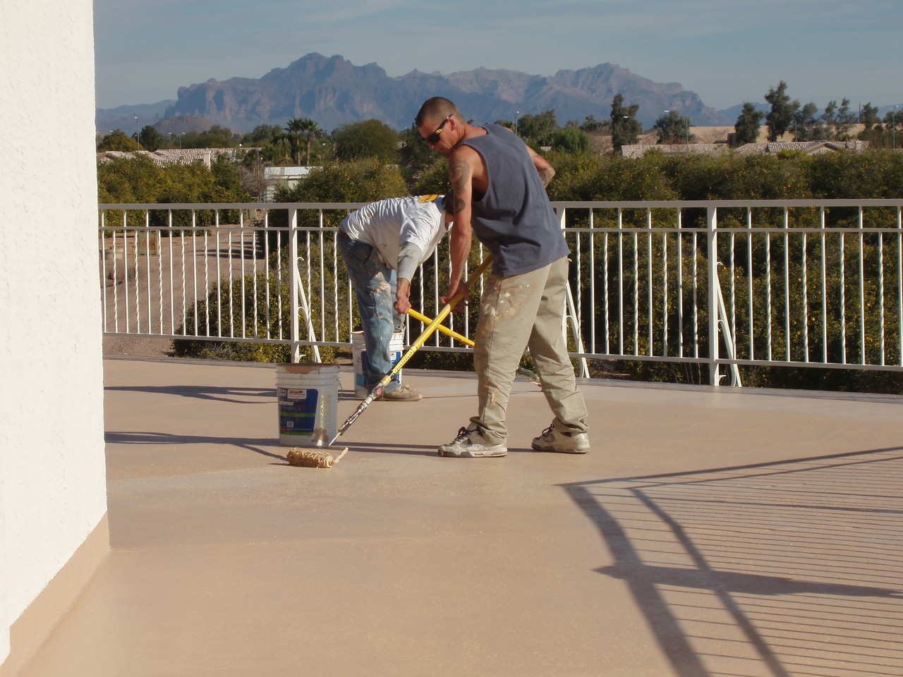 EnviroCoatings - Rolling the 2nd coat of Ceramic InsulCoat Roof at 2PM.  Project was completed by 5PM.