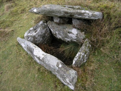 The stone cist within the cairn circle adjacent to Fernworthy Reservoir.