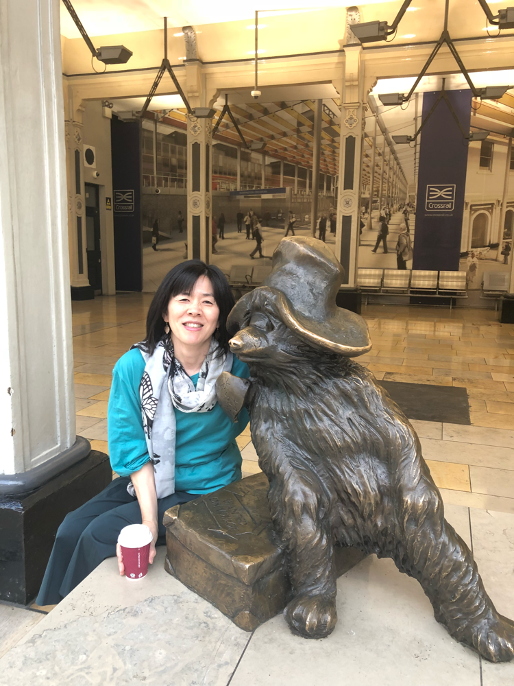 With Paddington Bear at Paddington station, London