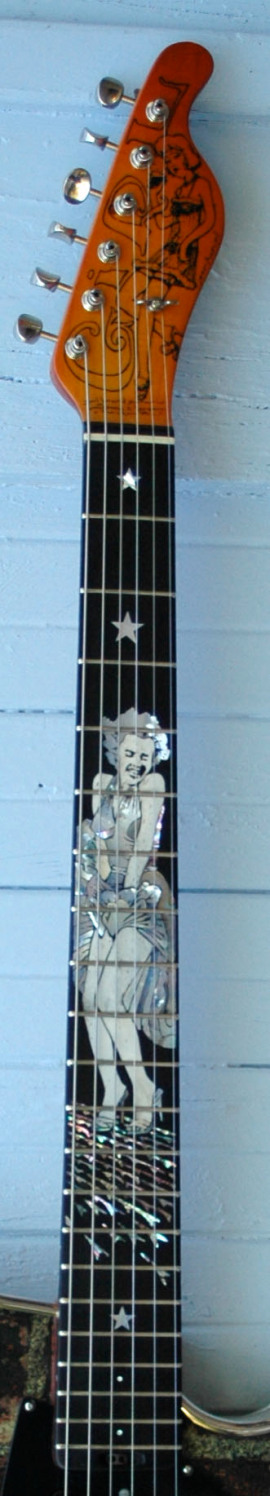 Girlbrand Hollywoodgirl fretboard. The Headstock girl has an unusual hairstyle!