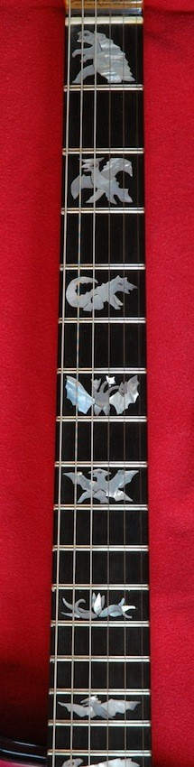 Girlbrand Kaijugirl fretboard with dragons. Owner/Photo: Henry Kaiser