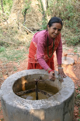 Woman with biogas digestor in Nepal