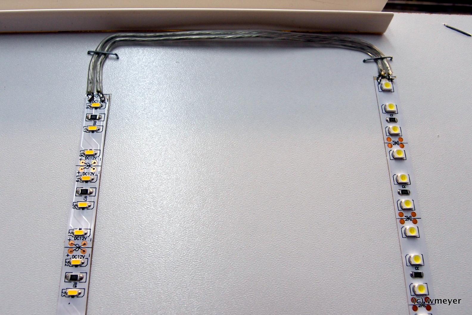 Lichtleisten durch altes Lautsprecherkabel verbunden und mit Tackerklammern befestigt