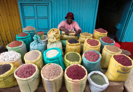 A woman prepares grains at her shop in the Kibera slum in the Kenyan capital of Nairobi, Jan. 20, 2012. Kibera is a vast shanty town that lacks even basic services such as sanitation. Many residents are angry that while prices of food have risen, wages ha