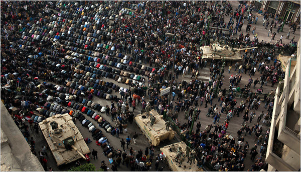 Egyptian protesters prayed Saturday in front of a military vehicles in Tahrir Square in downtown Cairo on Saturday