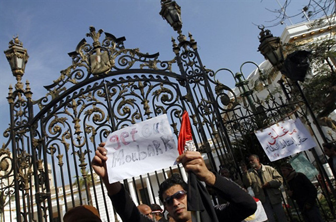 Pro-democracy protesters have gathered outside the parliament, near Cairo's Tahrir Square [AFP]