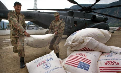 World Food Programme wheat is unloaded from a US navy helicopter in Pakistan. Photograph: Paula Bronstein/Getty Images