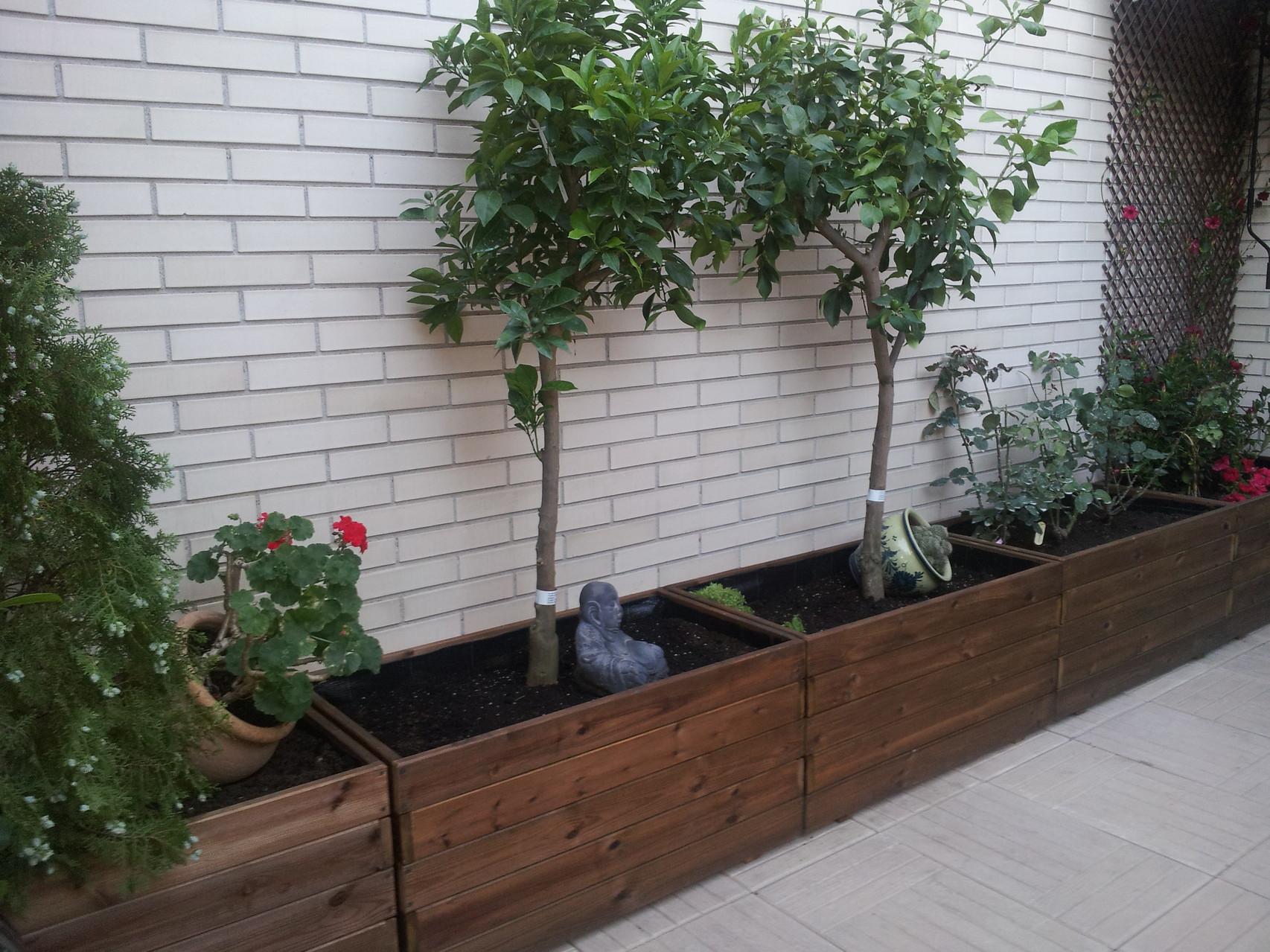 fotos de los clientes jardineras de madera