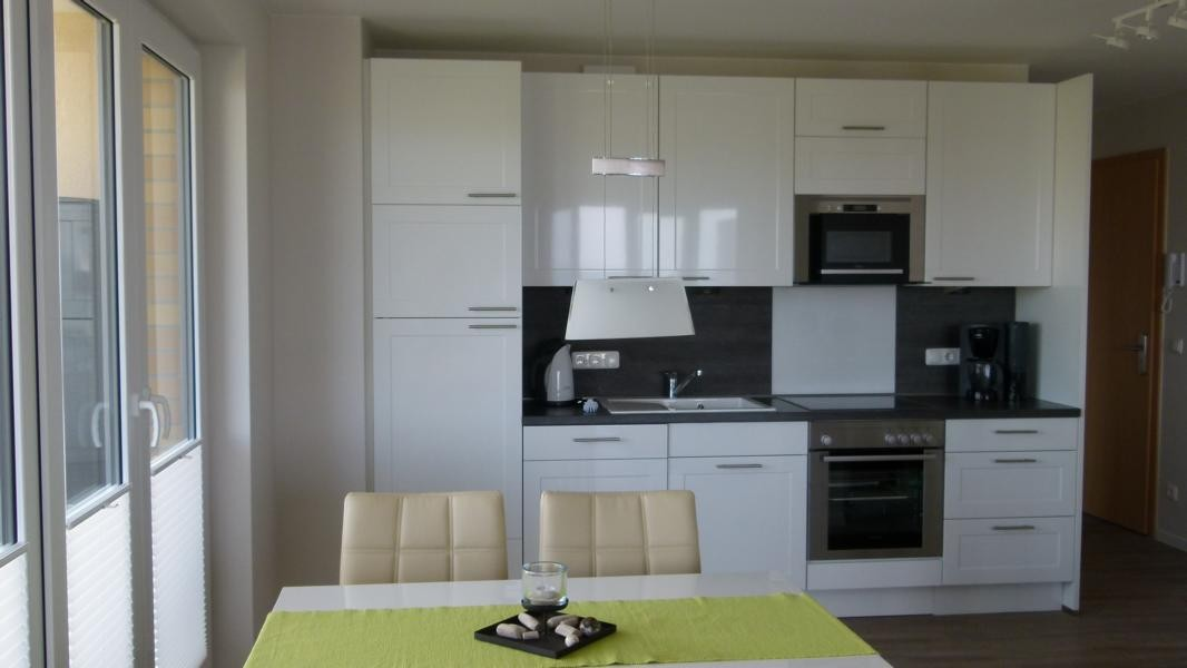 Küche und Essecke in der Ferienwohnung Arkonablick