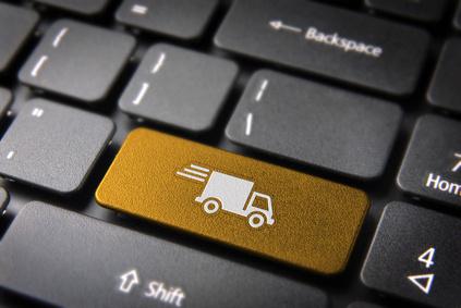 Tastatur mit der Taste eines Lieferwagens als Symbol für Abhol-Service