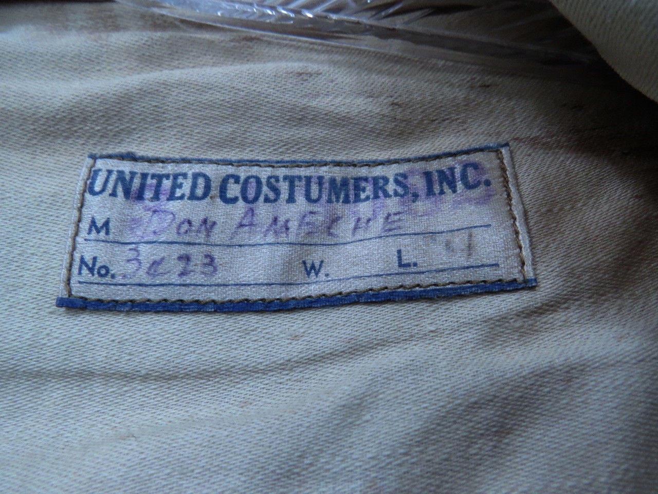 Etiquette de la UNITED CUSTUMERS (voir biographie) à l'intérieur du gilet. Le nom DON AMECHE est inscrit dessus.