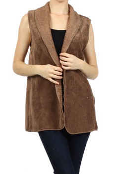 Soft, sleeveless faux fur open vest with lapel.   100% Polyester Made In: USA Sizes: S M L  PRICE  €69.99