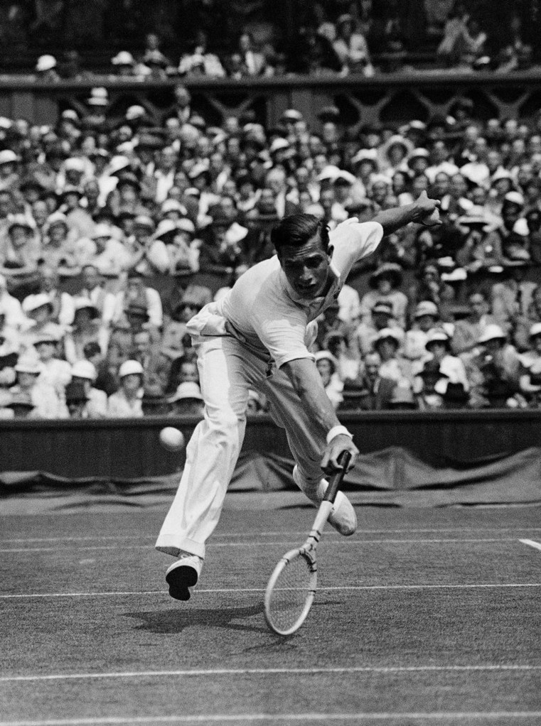 American tennis player Francis Xavier Shields, Frank Shields, in his match against Henry Wilfred Bunny Austin, unseen, whom he defeated on July 2, 1934, at Wimbledon, London. (AP Photo/Staff/Putnam)