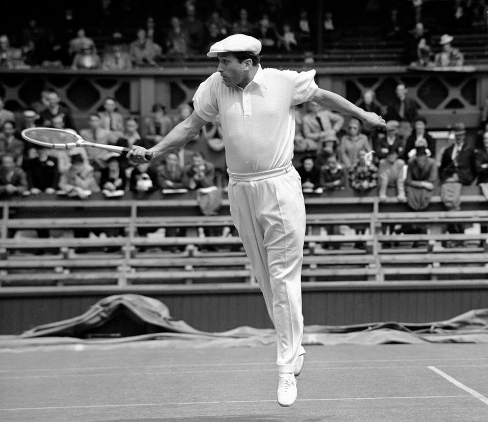 The 1939 Wimbledon tournament started on June 26, with a long programme of Men's Single matches as the opening attractions on all the courts. Roderick Menzel of Germany, in play against E.G. Peters, of Great Britain, in the opening match of the 1939 Wimbl