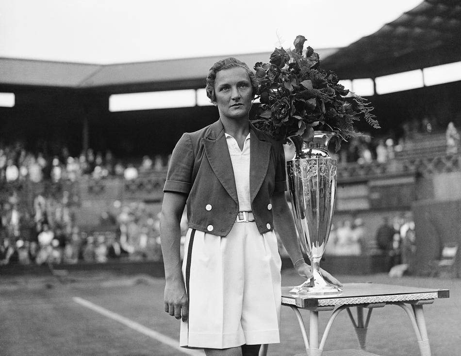 American tennis player Helen Jacobs with the Wightman Cup after the USA beat Britain at Wimbledon, London on June 16, 1934. (AP Photo/Staff/Putnam)