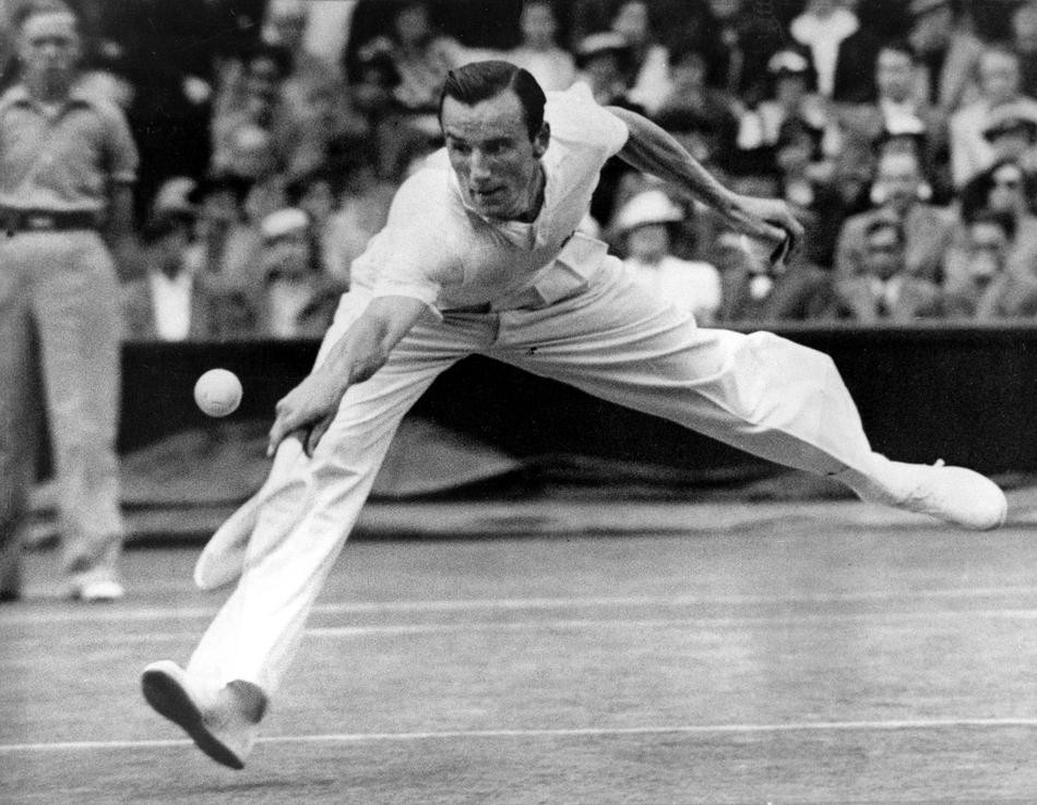 Fred Perry of Britain is shown in action in Wimbledon's Men's Singles at the All England Club in Wimbledon, England, July 3, 1936. Perry defeated Baron Gottfried von Cramm of Germany, 6-1, 6-1, 6-0, winning his third consecutive Wimbledon title. (AP Photo