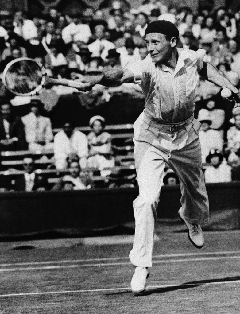 Jean Borotra in action against H.W. Artens of Austria, in early rounds of Wimbledon championship, in London, England on July 4, 1931. (AP Photo/Len Putnam)