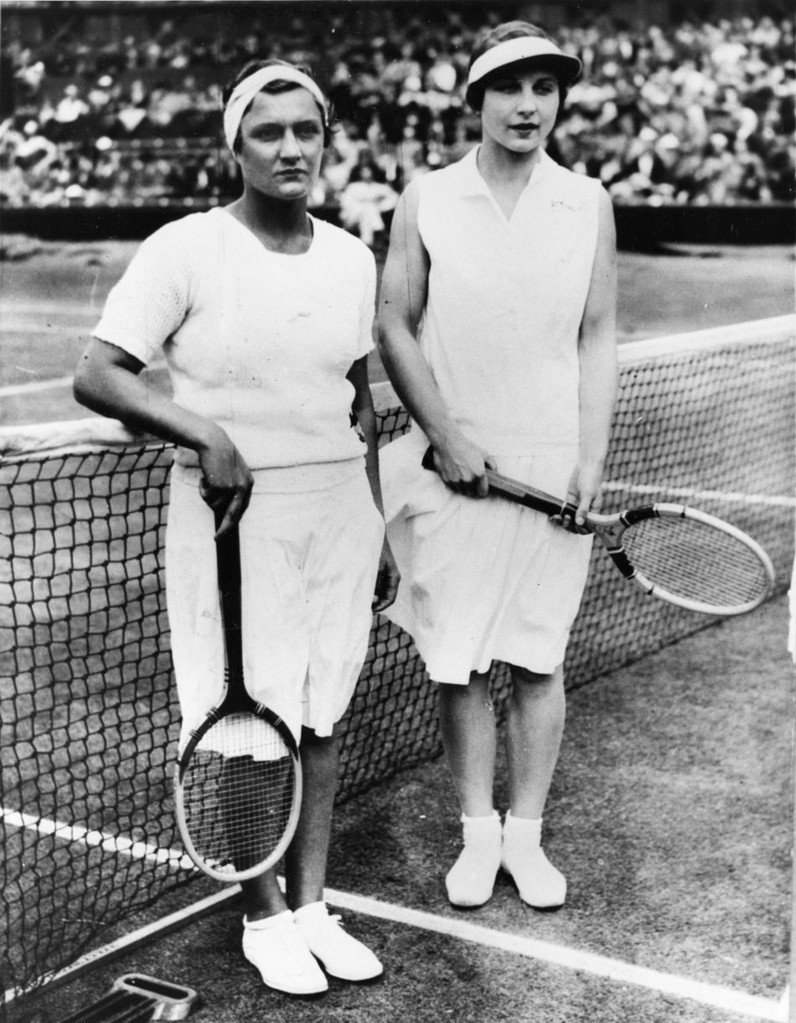 Helen Jacobs, left, and Helen Wills Moody, both ot the United States, pose before the start of the women's singles finals match on Centre Court at Wimbledon, England, July 1. The year is not known. (AP Photo)