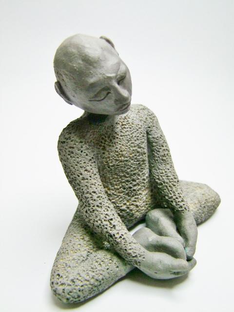 statuette homme en méditation