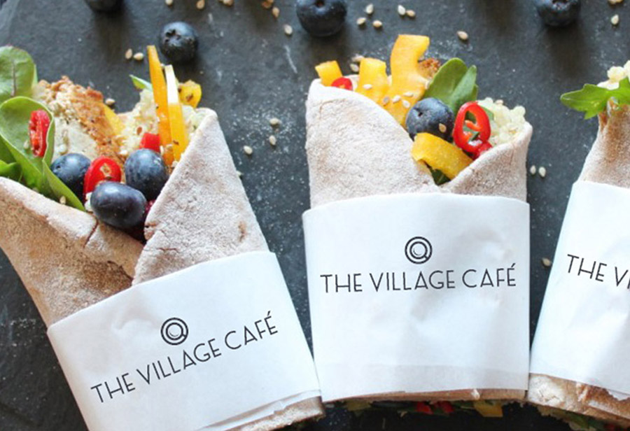 "Logo ""Village Café"", UNION INVESTMENT REAL ESTATE GmbH, Servietten"