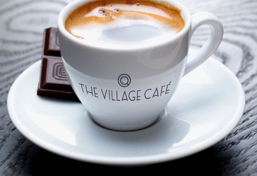 "Logo ""Village Café"", UNION INVESTMENT REAL ESTATE GmbH, Espresso Tasse"