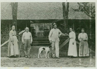 P.S. Deal (second from left), family, and dog