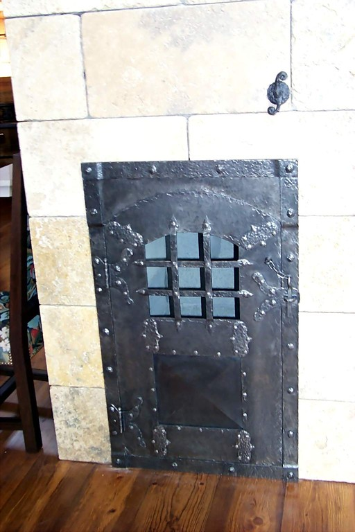Porte de monte - charge pour bois de foyer, en acier martelé et riveté