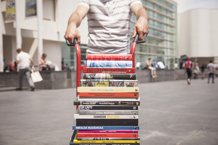 """Catalogues move along. Every day, everywhere. Here the catalogue """"Vinyl"""" in good company on the iconic square in front of Barcelona's MACBA, photo: Gemma Planell"""