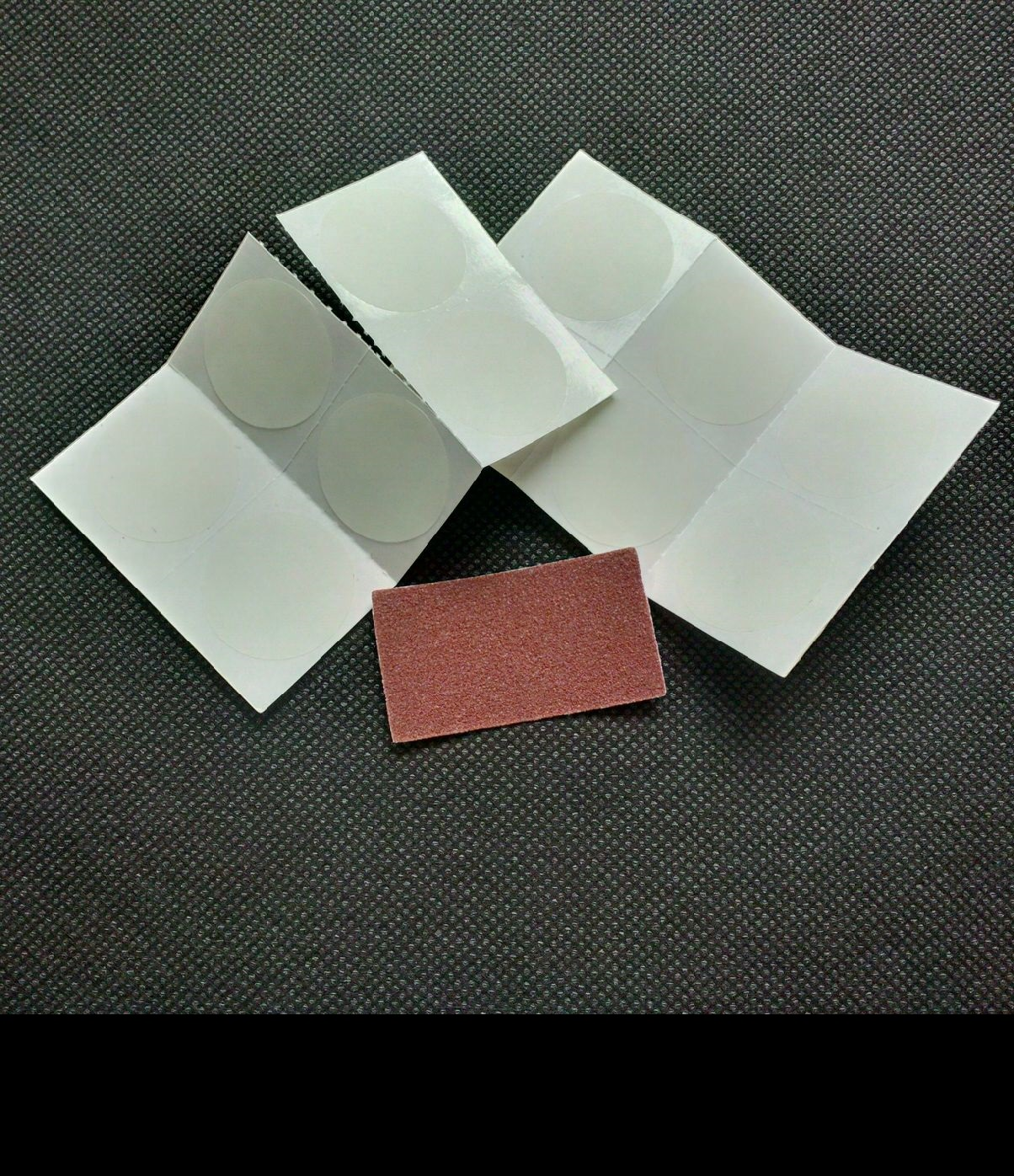 Puncture Repair Kits - 12 perforated patches with Sandpaper strip