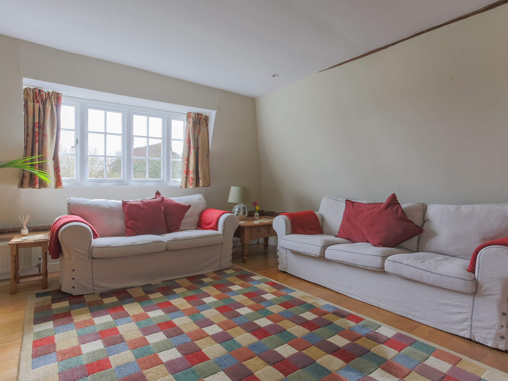 The sitting room is comfortably furnished and spacious