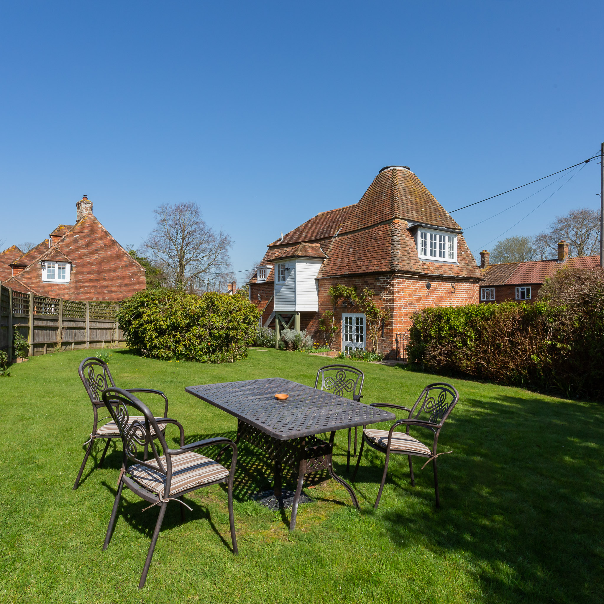 The garden is fully enclosed and well kept, with comfortable furniture and a barbecue
