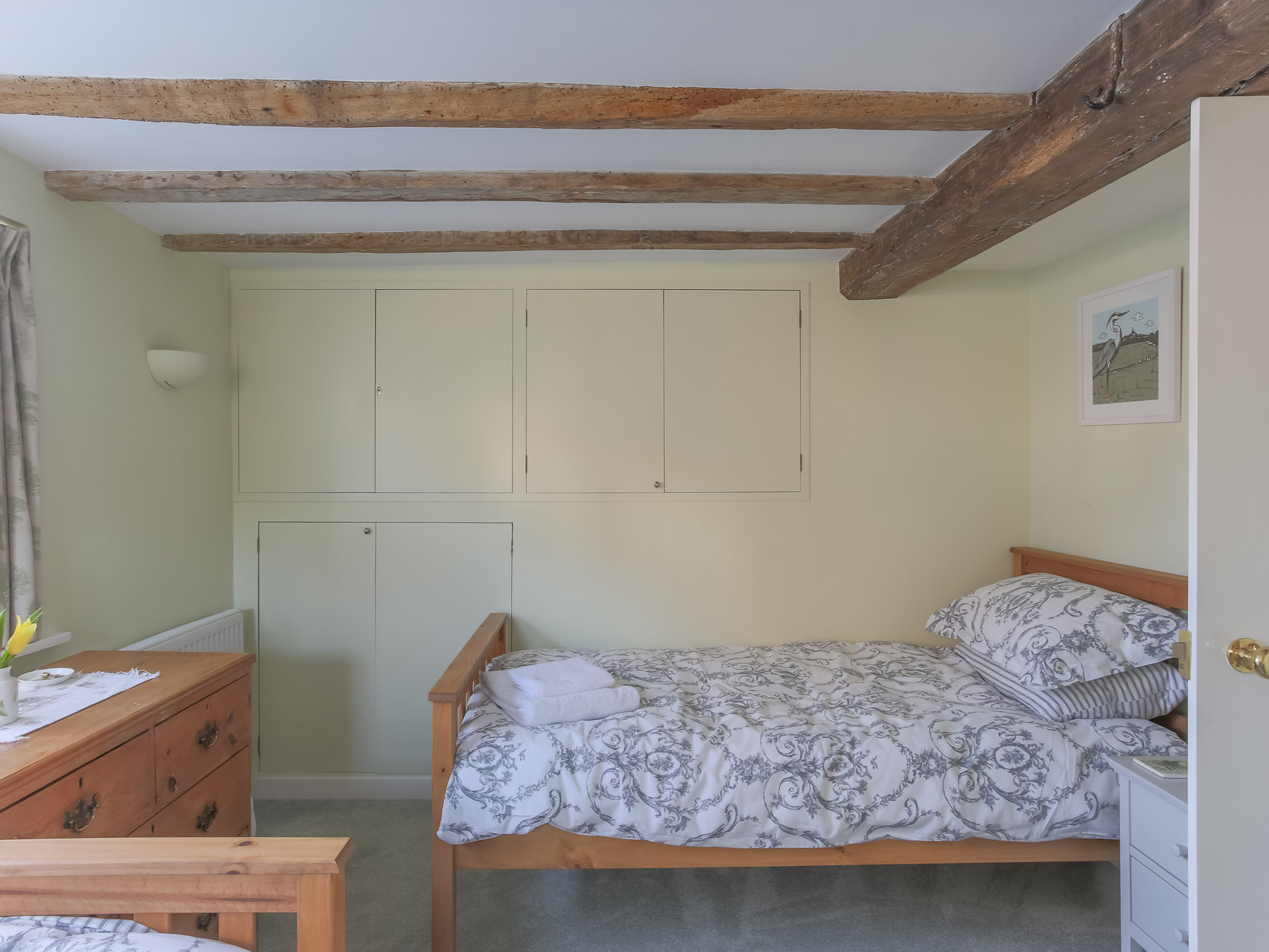 The room is cosy with built in cupboards to maximise space