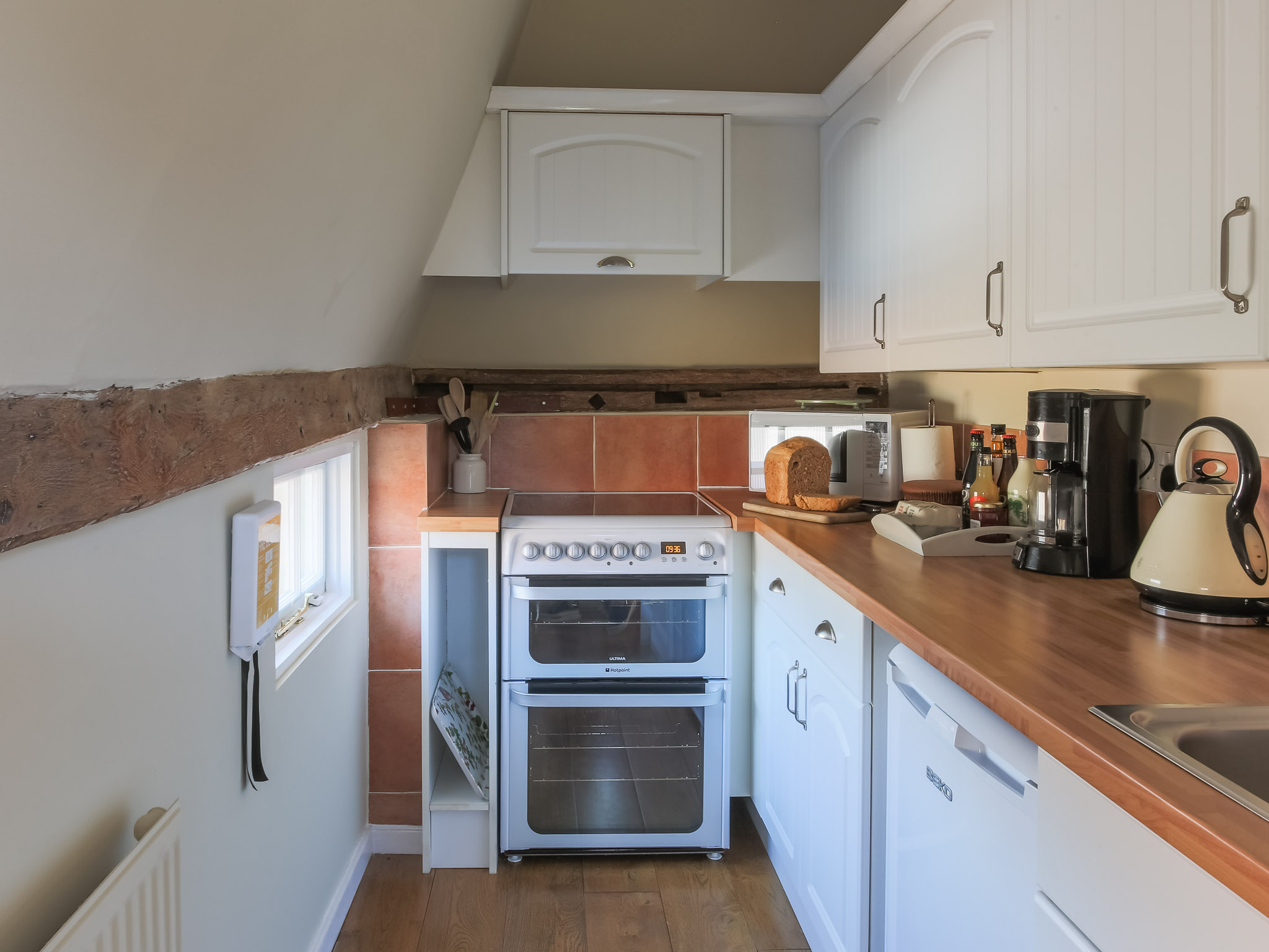 The galley kitchen leads off from the dining area