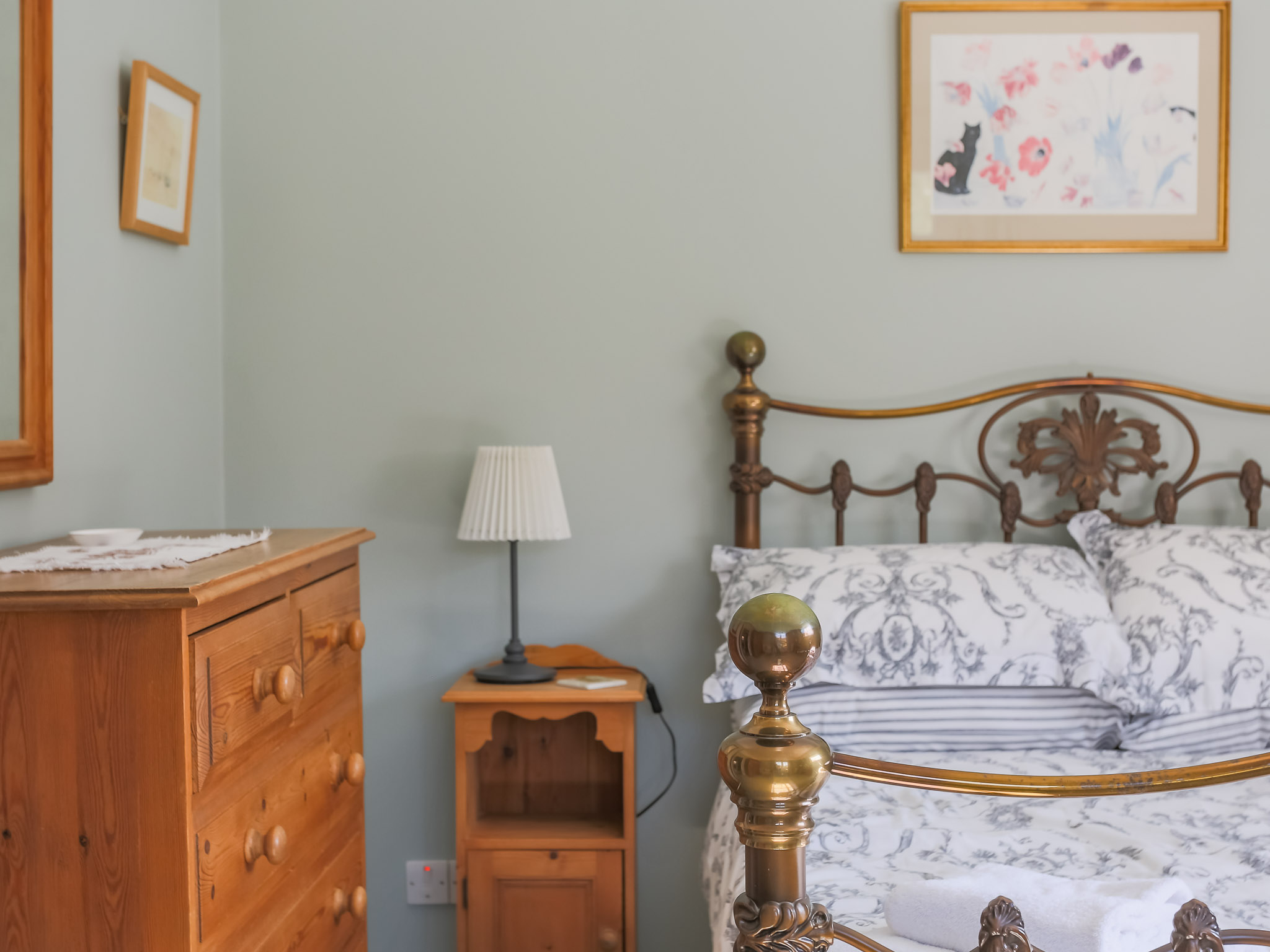 The room is tastefully and comfortably furnished