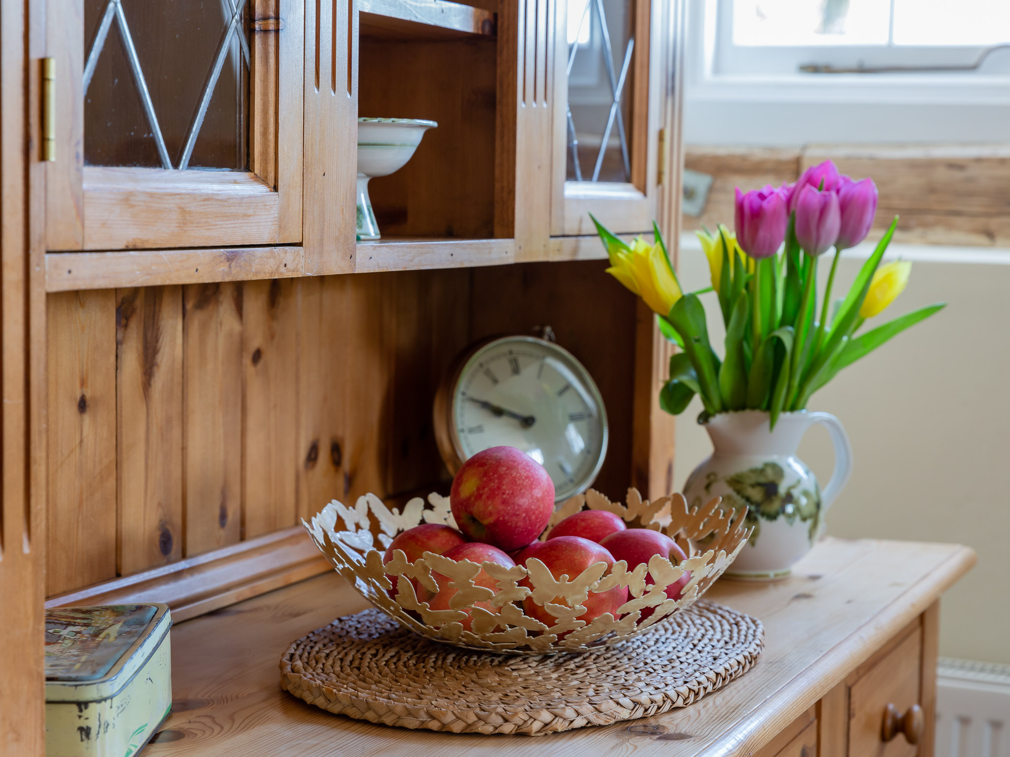 Local apples and flowers from the garden sit on the welsh dresser