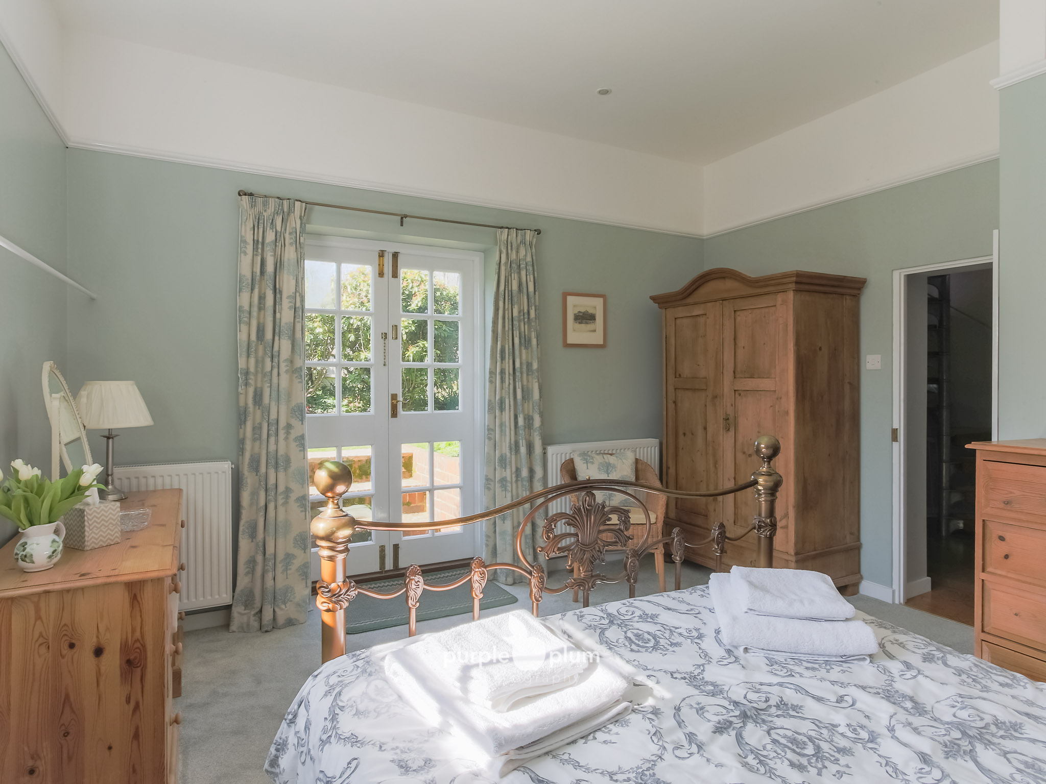 The french doors in the main bedroom lead directly on to the pretty garden