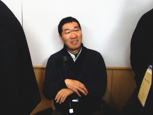 見守る田中先生