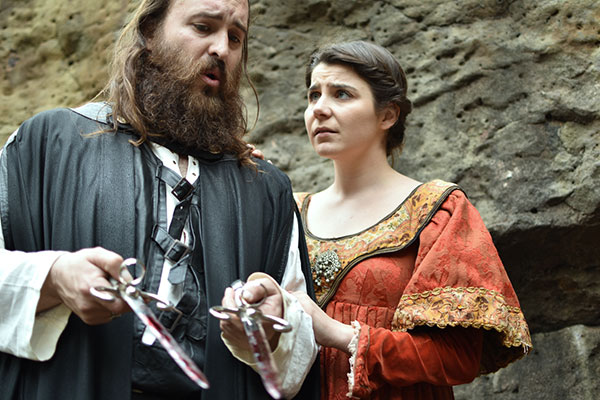 Macbeth and Lady Macbeth with bloody daggers
