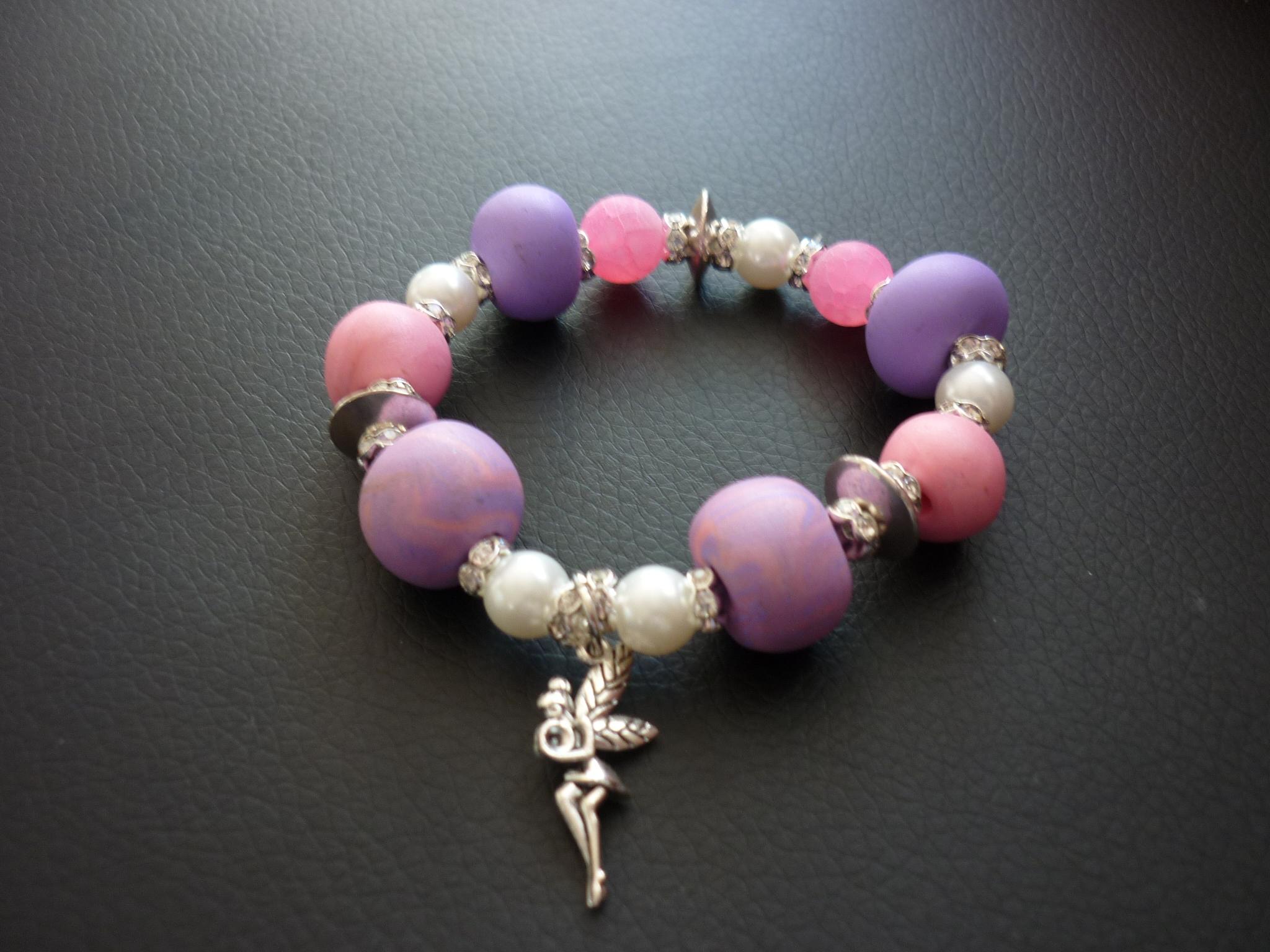 Armband - rosa / lila mit Fee 19.-