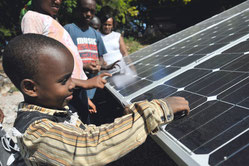 Children of the SOS Children's Village experience SOLARA solar modules