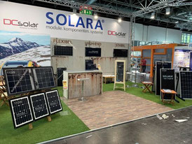 Solar technology in the caravan salon for campers, caravans, motorhomes and campers. Charge controller, fastenings for solar modules on the camper roof.