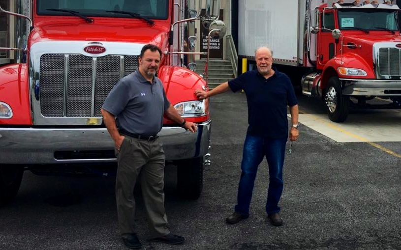 "Pete and Paul with our brand new ""tomato red"" company trucks"