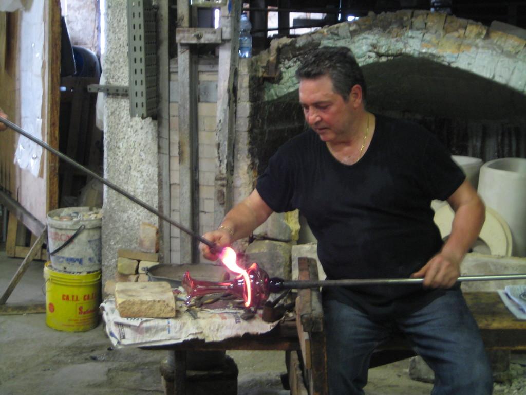 Murano glass worker. The glass has around 1300degreeC!