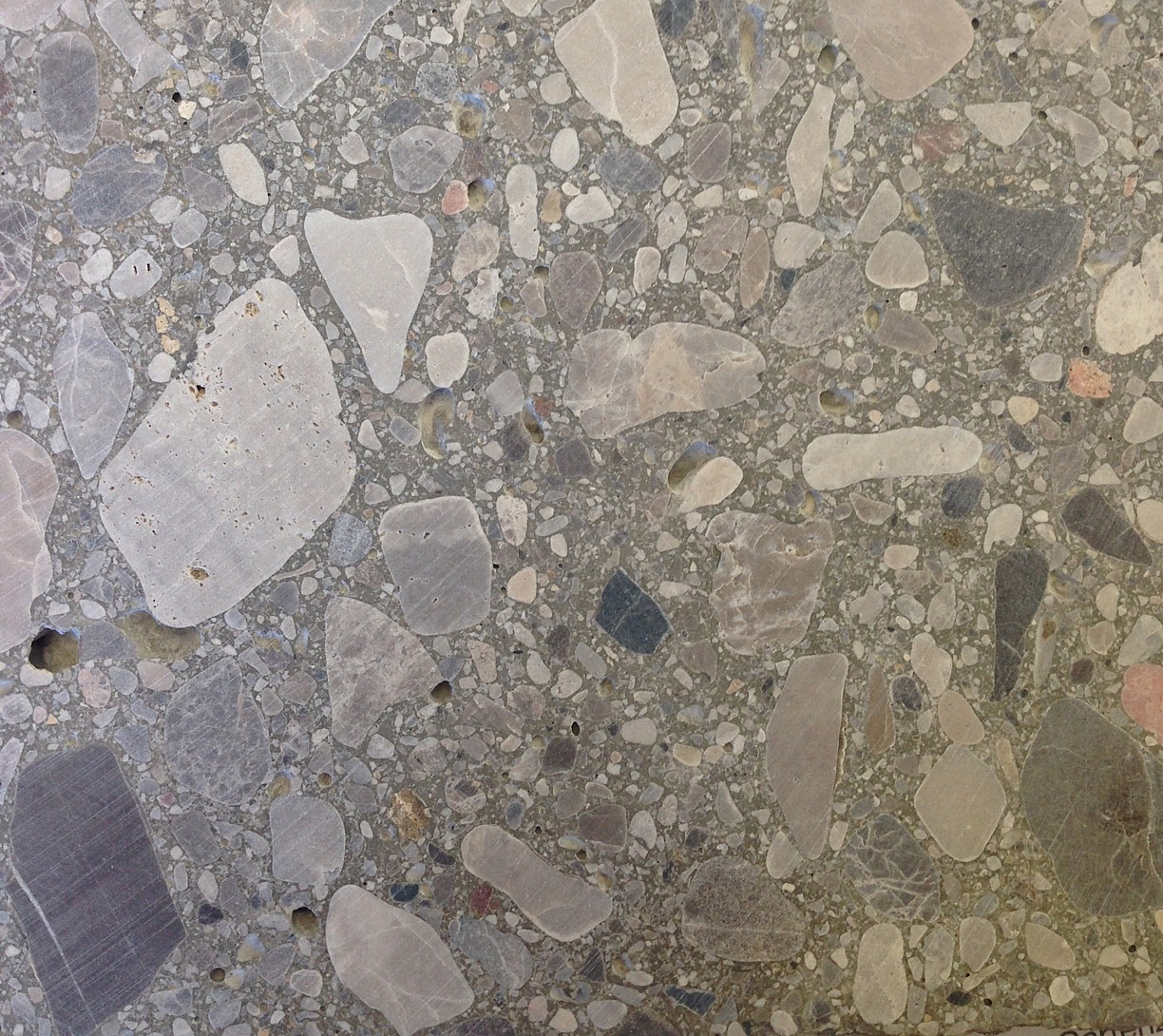 concrete with rough stones, polished