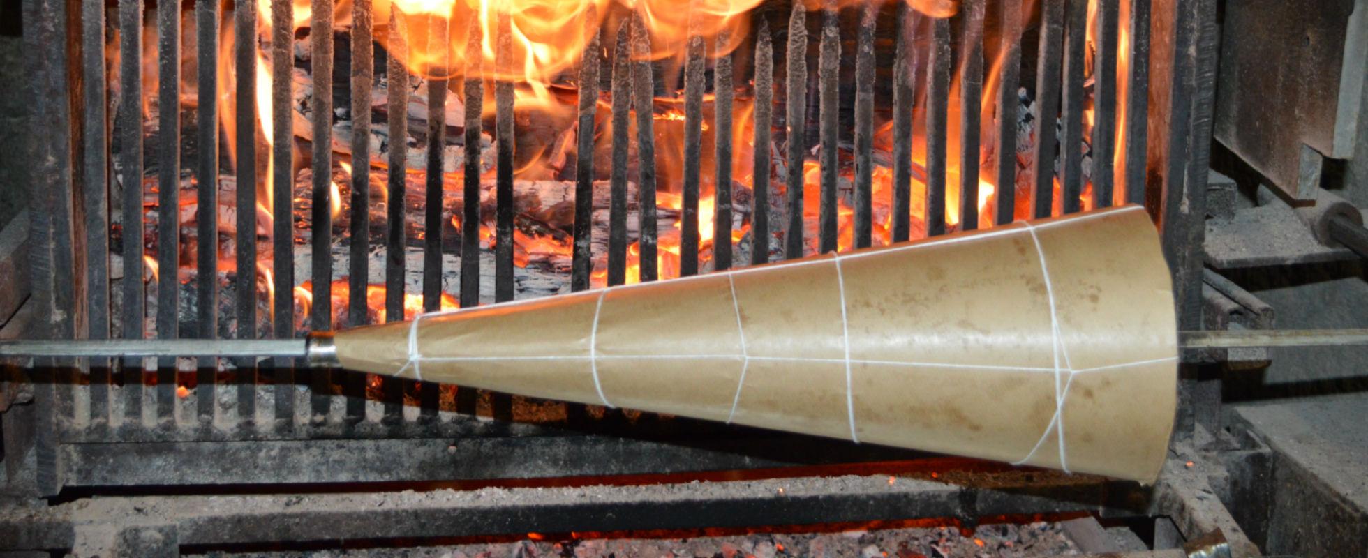 Faire chauffer le cone pour la réalisation du gâteau à la broche