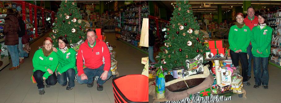 Auf den Bildern sieht man Fressnapf - Chef Axel Henschke, die Filialleiterin Jeanette Kinsik und  Mitarbeiterin Alexandra Zobel vor dem Weihnachtswunschbaum und den gespendeten Geschenken.