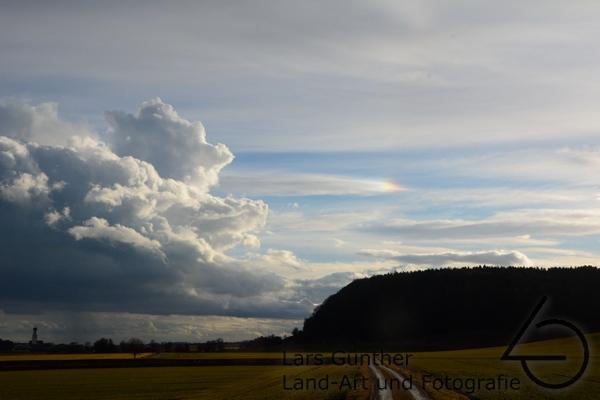 Wolkenhimmel und Nebensonne